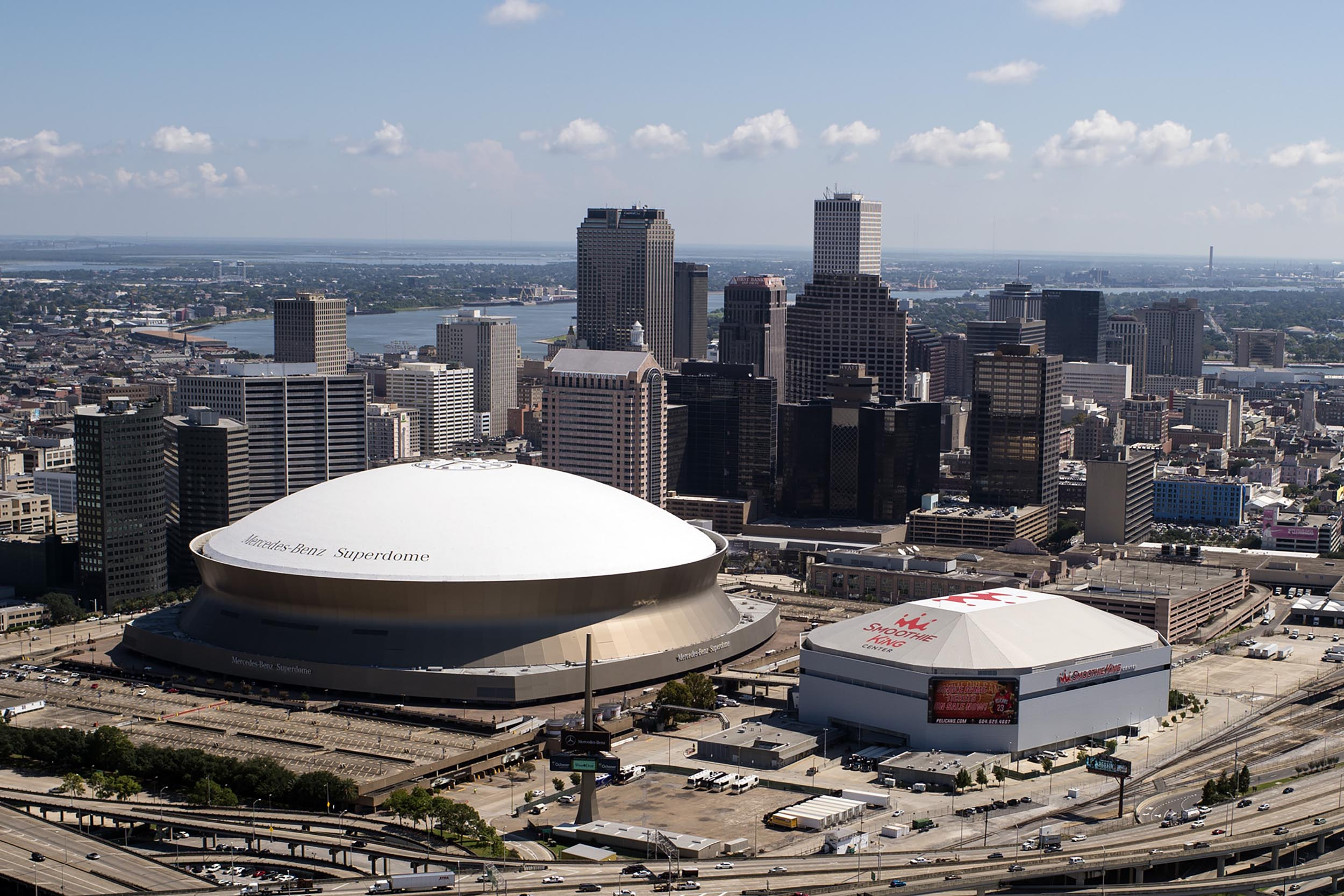 The Mercedes Benz Superdome, Smoothie King Center, and downtown skyline