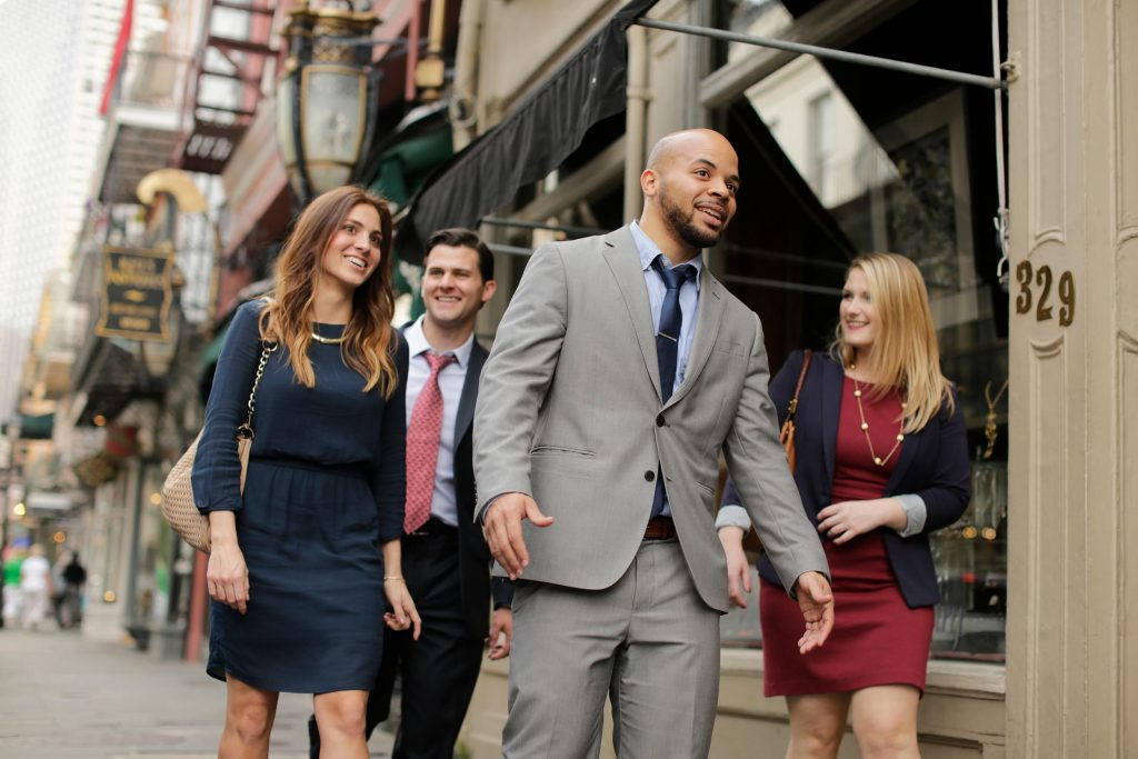 A group of business people walk downtown